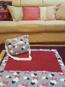 Red quilted ladies masalla bag with heart & Bow Design.