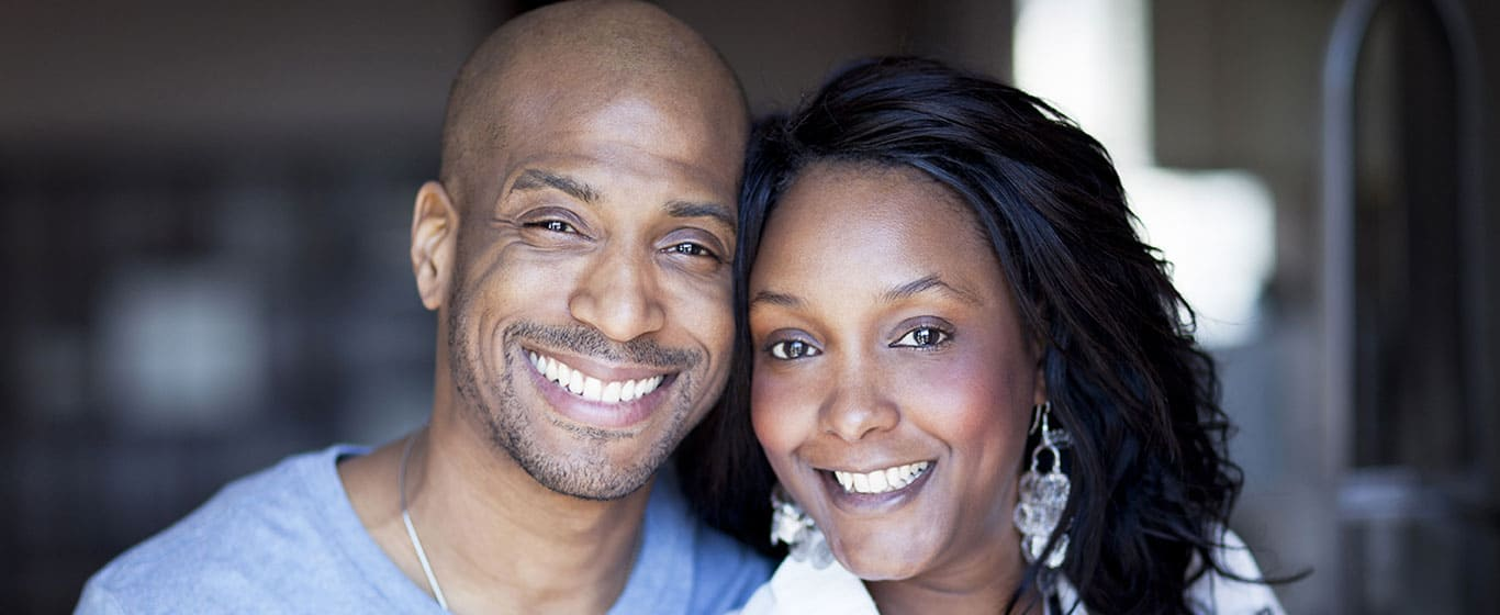 Couple smiling after visit with dentist