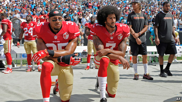 Colin Kaepernick (right) and teammate Eric Reid (left) kneel during the National Anthem