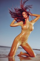 The flat beaches of Mexico mixed with a slim catsuit can produce surreal imagery