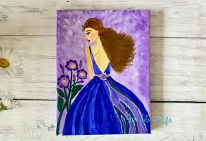 Lady in the purple dress give color to life