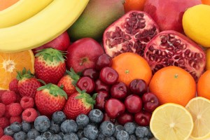 Fresh mixed fruit superfood background with fruits high in antioxidants, vitamin c and dietary fibre.
