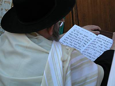 Man reading prayer book