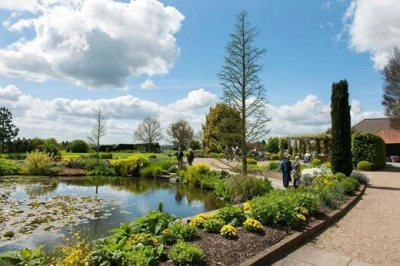 Visitors-by-the-Lower-Pond-in-Spring-at-RHS-Garden-Hyde-Hall_MAR0006567_94105