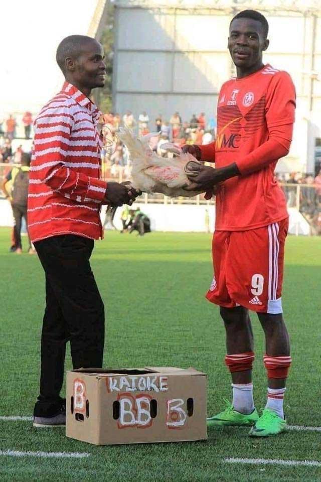 Footballer Hassan Kajoke of Malawi receives chicken for man of the match award.