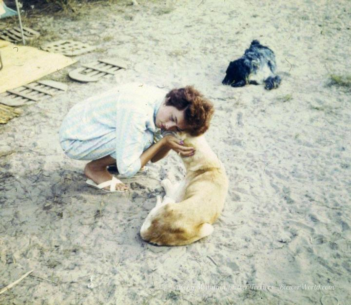 Gertrud Biewer hugging a stray dog at the campground