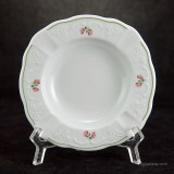 Beautiful Austrian porcelain with hand-painted antique wild rose décor and garden green trim.