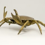 This vintage brass crab is hiding an ashtray beneath its shell.