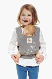 Child carrying her doll in an ergo