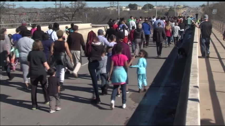 Hundreds of people walk in 27th Annual MLK Day_84054769