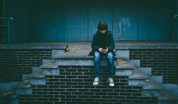 Cyberbullying boy on phone