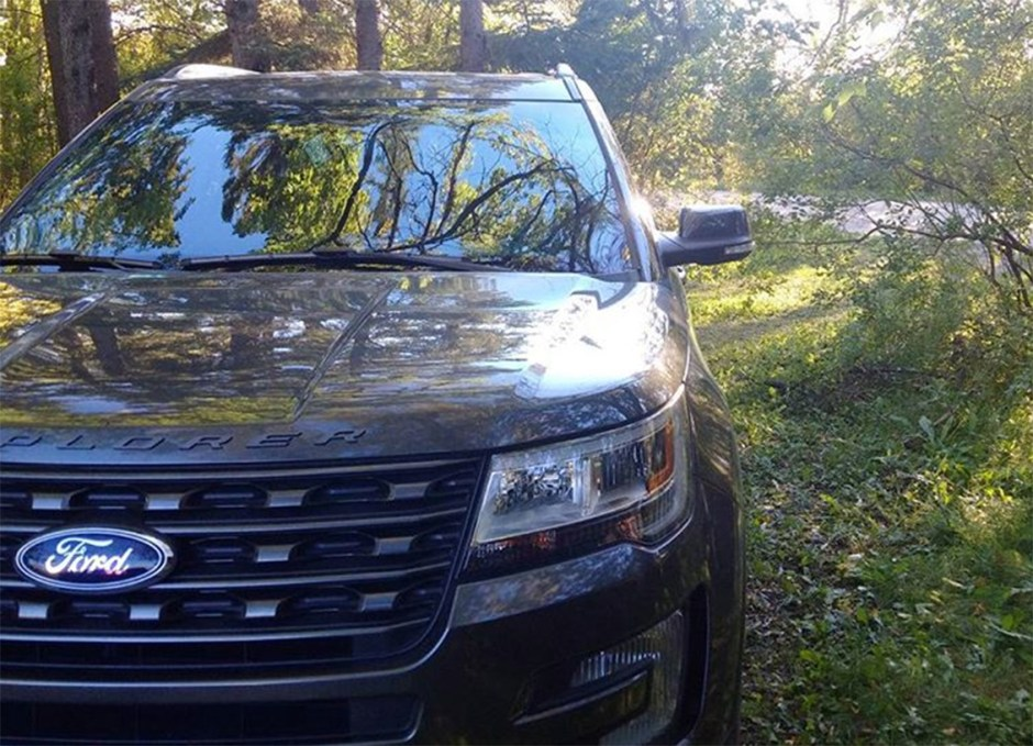 ford explorer in woods