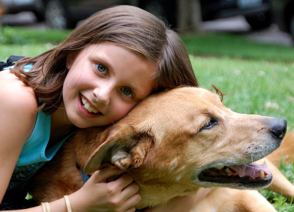 emotionally intelligent girl with dog