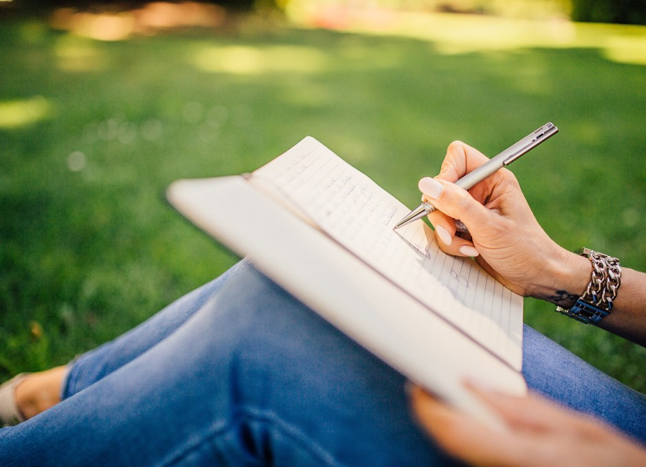 guest bloggers writing in notebook