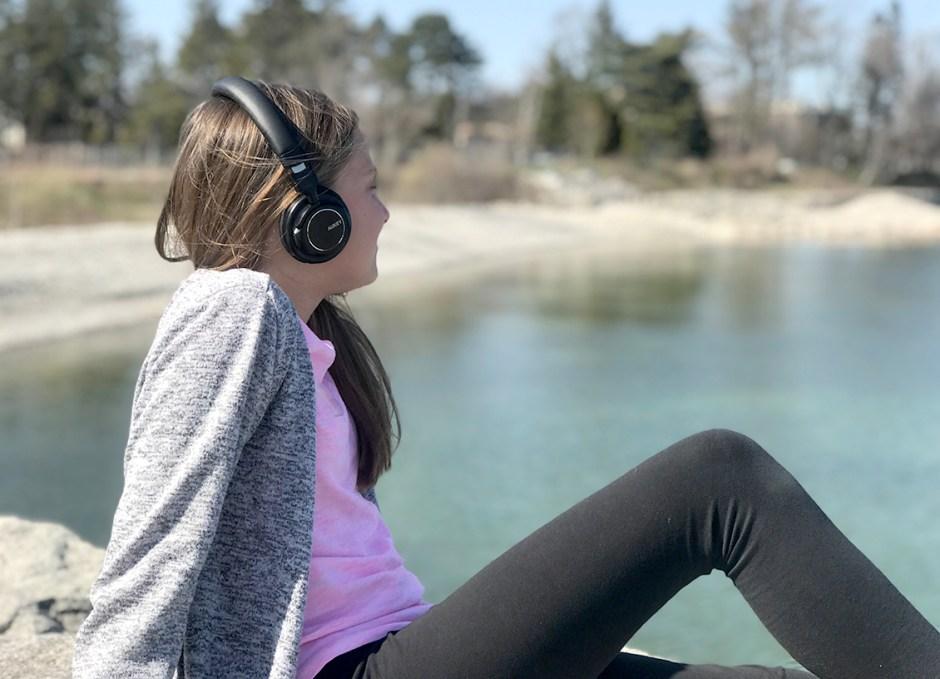 EP-B36 Bluetooth Headphones Lauren on rocks