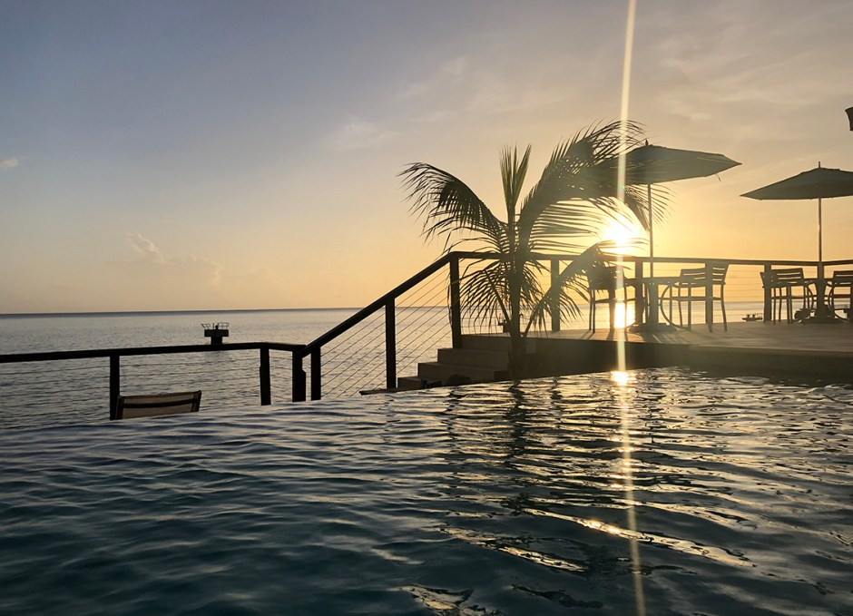 FORT YOUNG HOTEL SUNSET OVER INFINITY POOL