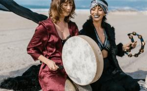 two women near water body