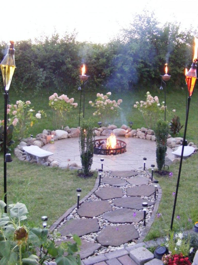 Perfect Torches with Flagstone Walkway for Inexpensive ... on Cheap Backyard Patio Ideas id=36908