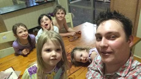 Selfie of Master22 home and playing Tsuro with five of his younger siblings :)