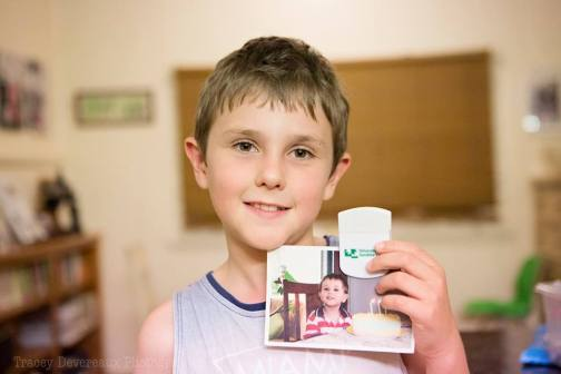 Master9 on his recent 10th birthday, holding a photo of himself at 3