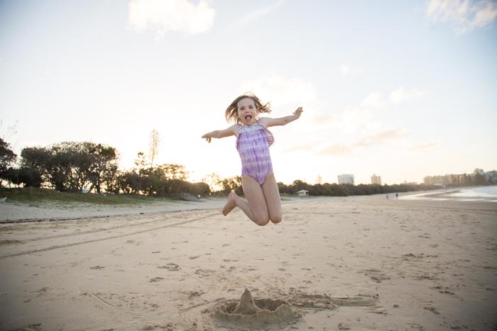 molly-jumping-beach-1