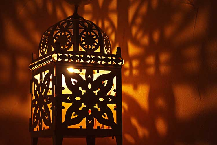 Moroccan lamp that is glowing with low level lighting