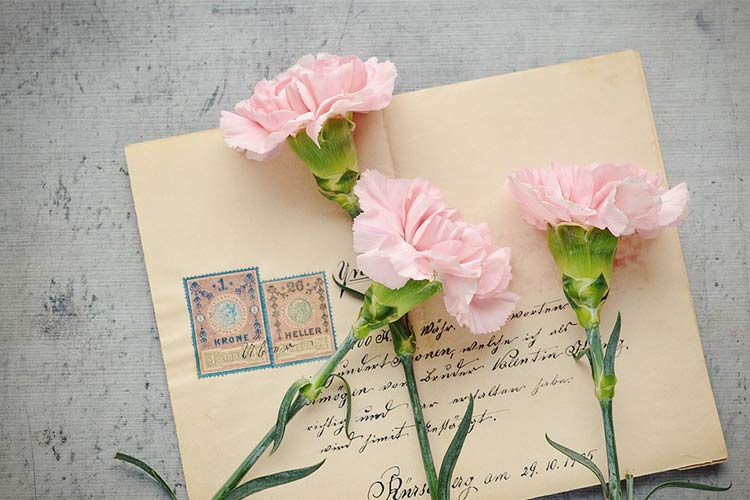 Handwritten post letter with pink flowers
