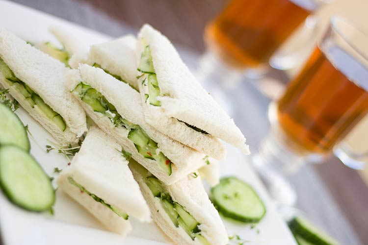 Cucumber sandwiches on white bread with crusts cut off, party food