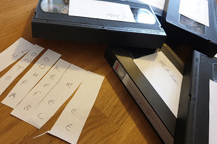 written clues inside VHS tapes