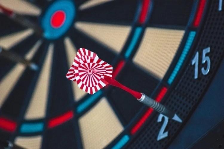close up of a dart in a dartboard