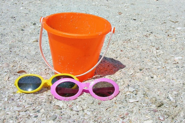 Orange bucket and sunglasses