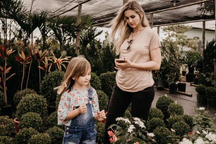 Woman and child gardening in a greenhouse