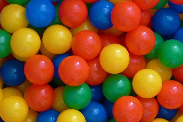 lots of primary coloured balls for the toddler group game