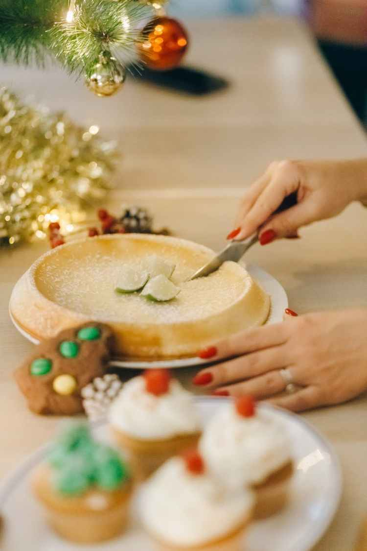 person slicing cake for Festive Tasting Family Christmas game