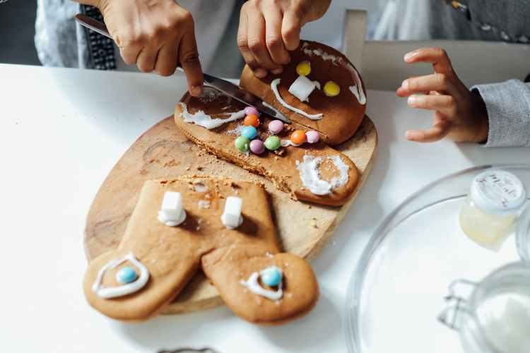 people decorating a cookie