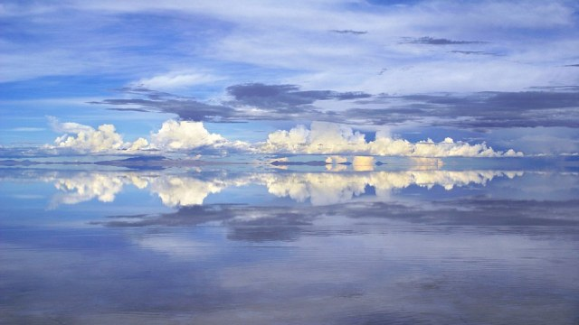 Reflections in the flooded salt desert Salar de Uyuni, Bolivia. Sunset
