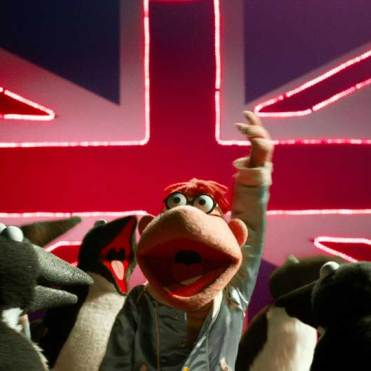 The Muppets in front of a Union Jack