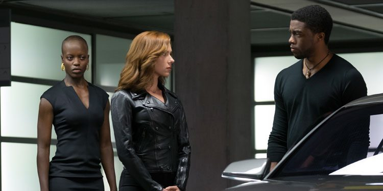 Florence Kasumba (far left) as Ayo in Captain America: Civil War