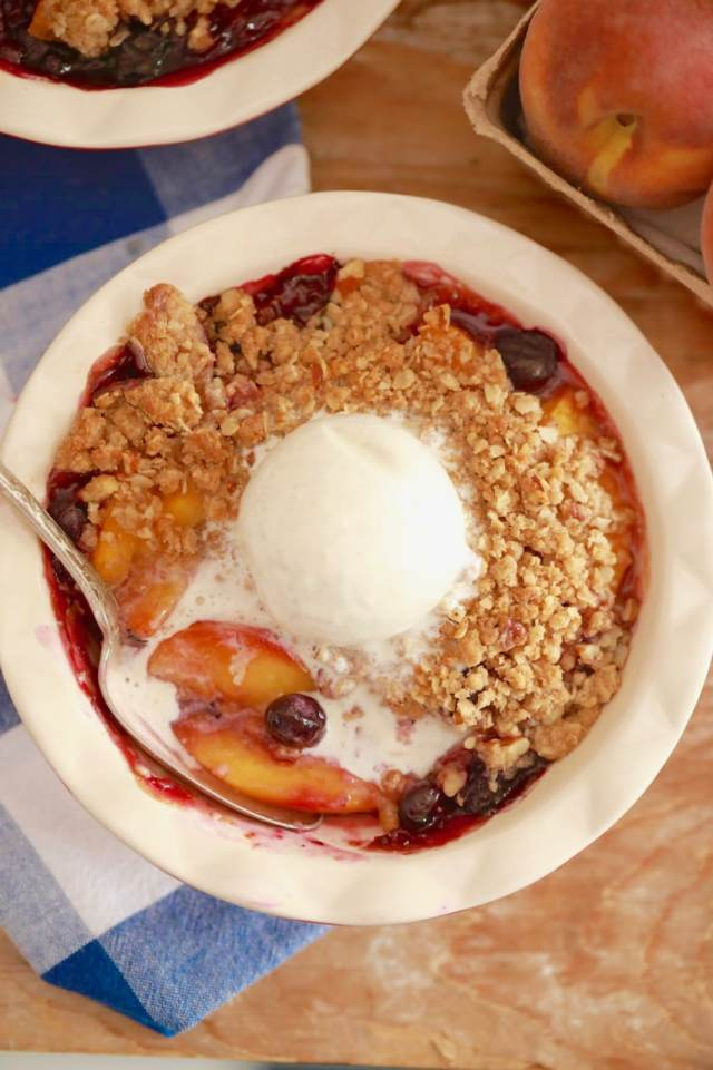 Peach and Blueberry Crisp Recipe Topped with Ice Cream