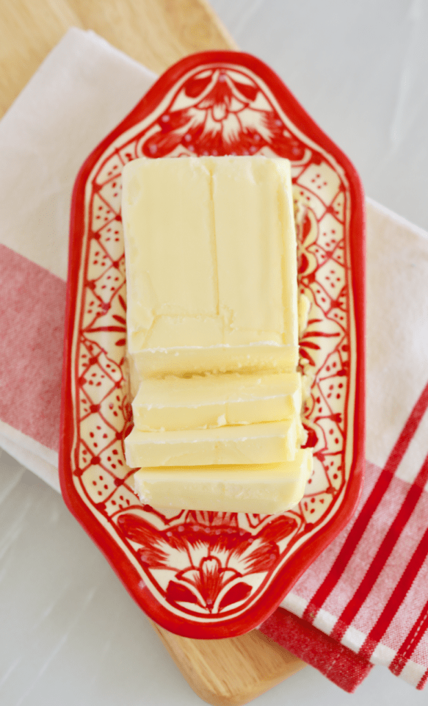 Salted butter, sliced and in a butter dish, and not Unsalted Butter.