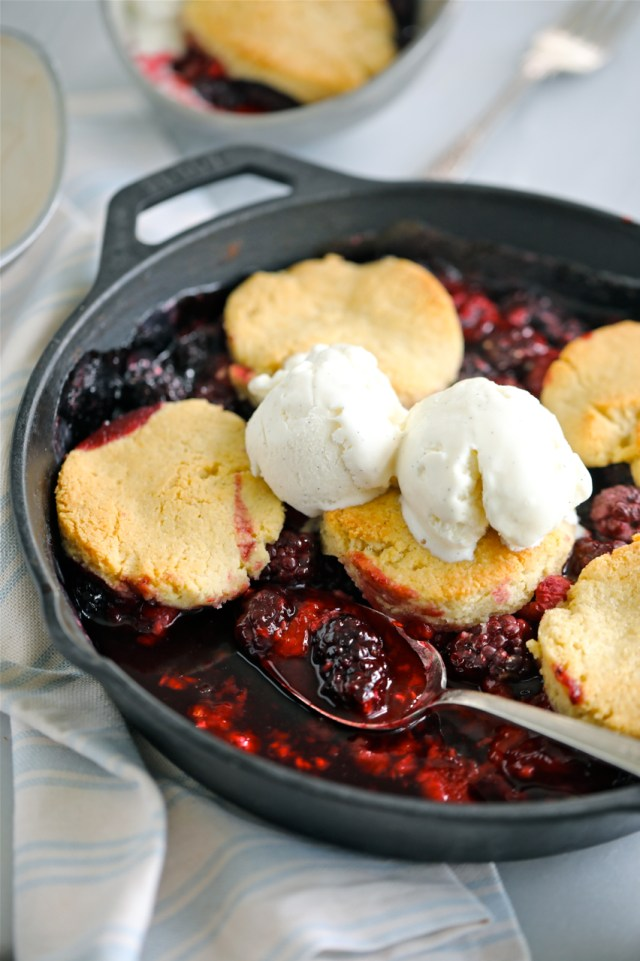 Low sugar cobbler with biscuits and ice cream on top.