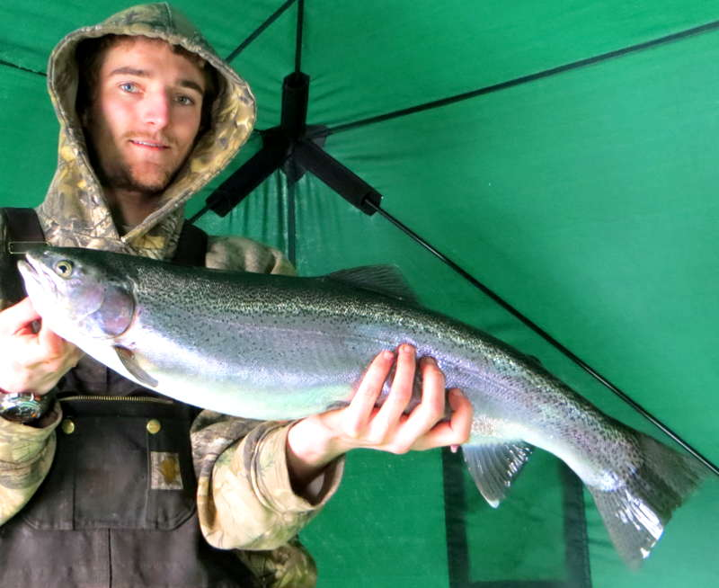 Mitch with his first big Lake Superior rainbow through the ice.