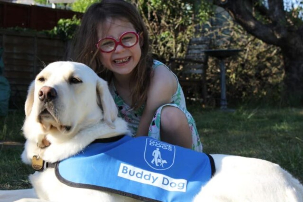 Buddy dog Molly improves little Grace's life