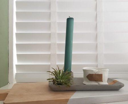 Waxinelichthouder van klei
