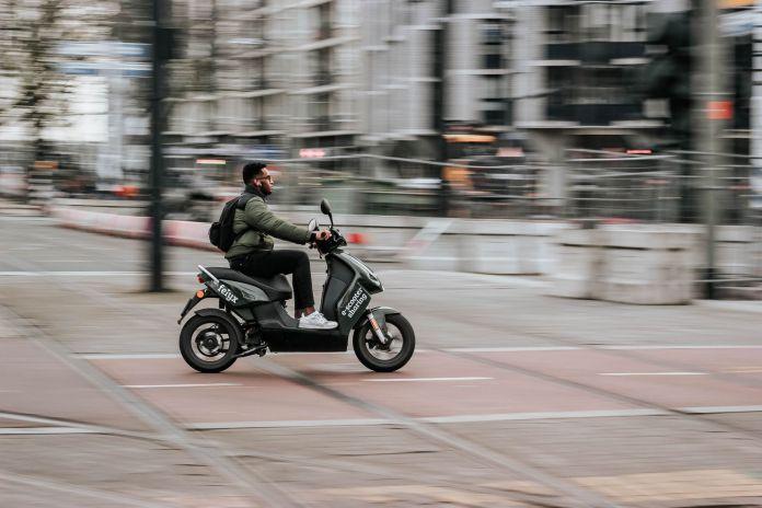 Man riding an e-scooter