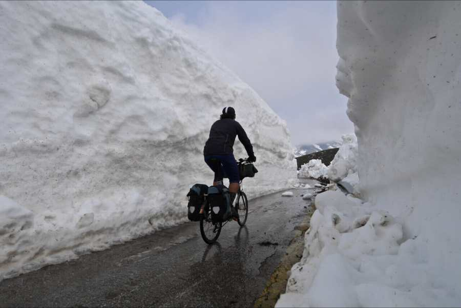 Cycling through a snowy mountain pass in Greece