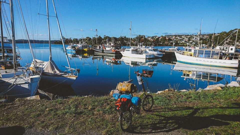 Tasmanian coast with ships and a bike