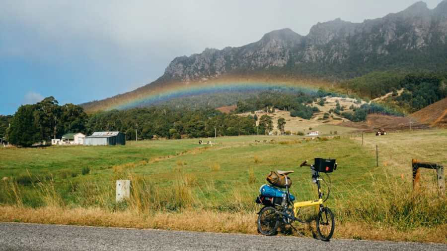 Cycling under a rainbow in Tasmania