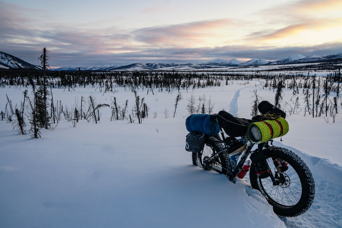 Panniers are a lot easier to pack than typical bikepacking bags, and might be a better option for winter trips.