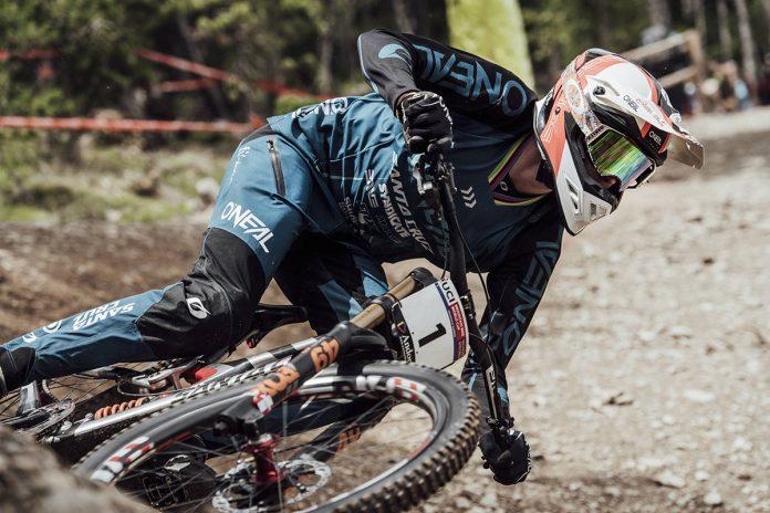 Greg Minnaar racing Downhill Mountain Biker